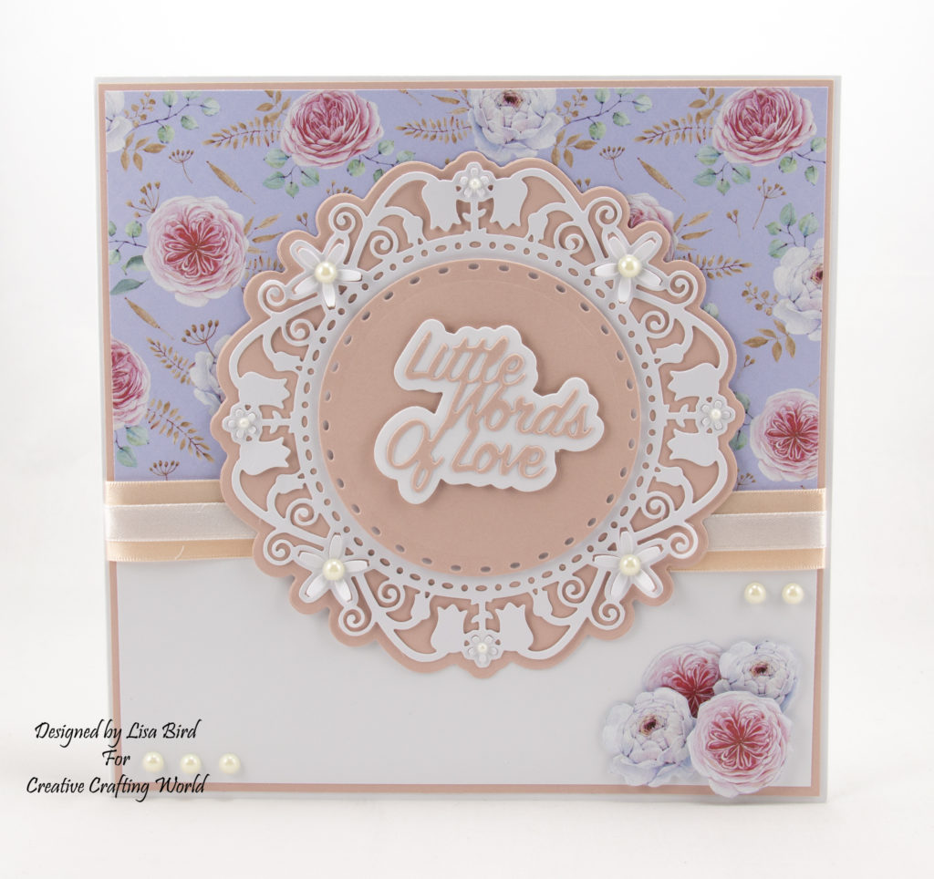 Today's handmade card has been created using a new die and paper collection fromCreative Crafting Worldcalled 'Springtime Blooms'.  This is another die and paper collection from The Paper Boutique range.