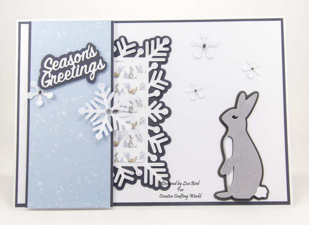 Handmade Christmas card with rabbit die and snow flakes