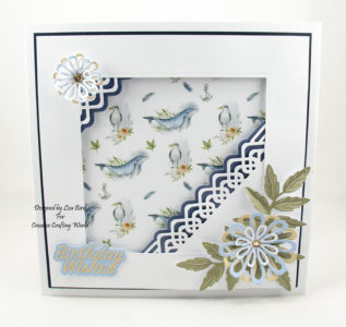 Handmade card using Ocean Breeze with flowers and whales