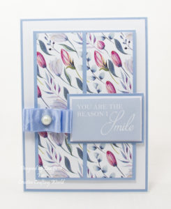 handmade card has been created using a Paper Boutique paper collection from Creative Crafting World called Floral Daze
