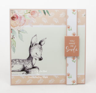 handmade card has been created using a paper collection called Enchanted Forest