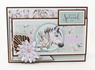 Today's handmade card has been created using a Paper Boutique paper collection from Creative Crafting World called Safari Buddies.