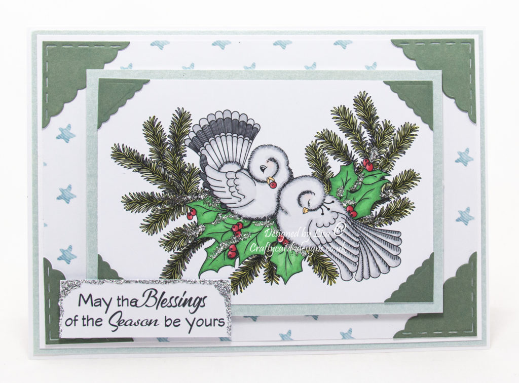 Today's handmade card has been created for the new challenge at Aud Sentiments challenge blog using a digi image called Christmas Doves