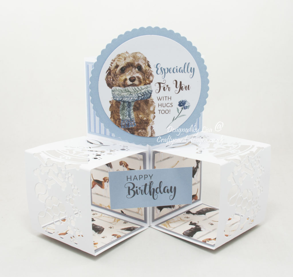 Handmade card using  a paper collection from Creative Crafting World called It's A Dog's Life